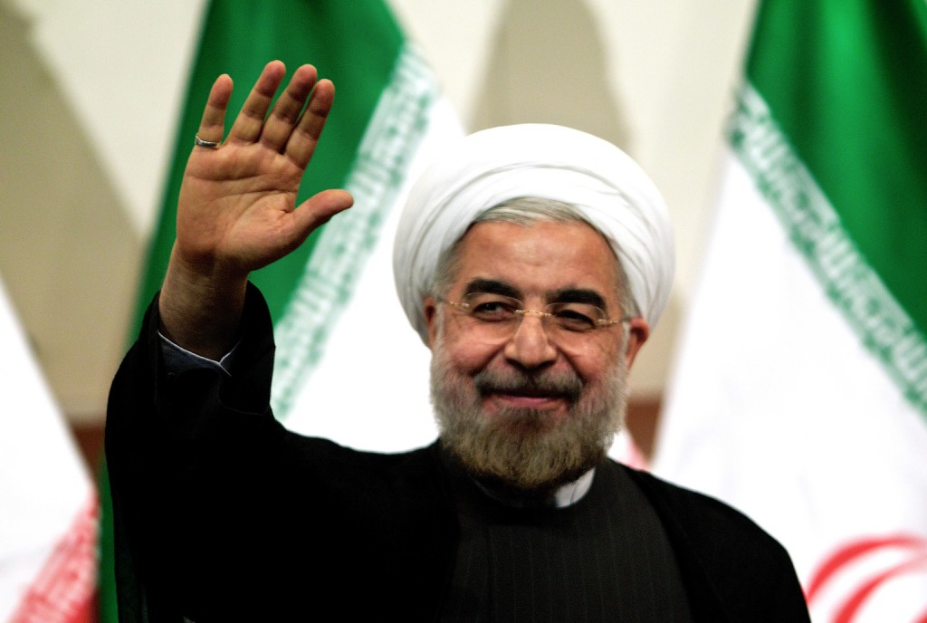 (FILES) A picture taken on June 17, 2013 shows Iranian president-elect Hassan Rowhani waving as he attends a press conference in Tehran. Rowhani, the cleric and reputed moderate who is to be sworn in as Iran's president on August 3, has vowed to engage more with world powers in hopes of easing economic sanctions. AFP PHOTO/BEHROUZ MEHRI (Photo credit should read BEHROUZ MEHRI/AFP/Getty Images)