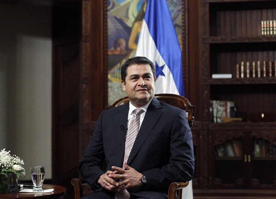 Honduran President Hernandez sits in his office during an interview with Reuters at the presidential palace in Tegucigalpa